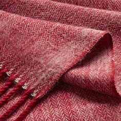 throw for bed to work with red in rug and bring in some texture