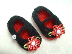 Cute little Mary Janes in black and red with a ribbon flower. For 3-6 month old  $18