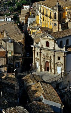 Ragusa Ibla, Italy with its tiled roofs and the elegant convex facade of Chiesa del Purgatorio