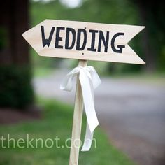 Simplistic signs pointing the way to the wedding from the highway or main road?