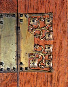 Arts & Crafts hinge. Artsy, elaborated hardware was often the only Arts & Crafts allusion on an otherwise generic Grand Rapids piece.