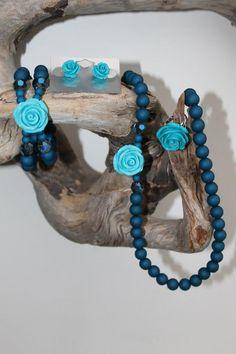 ketting, armband, oorbellen en ring met roosje