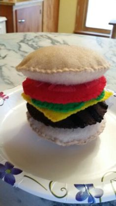 Felt food cheeseburger with lettuce and tomato.