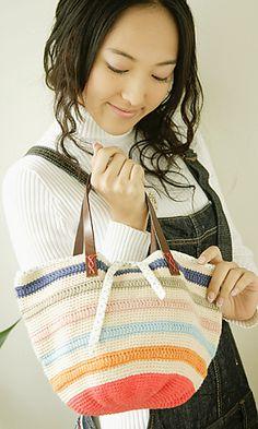 Free crochet pattern (In English!!) for a Striped Bucket Bag at: http://gosyo.co.jp/english/pattern/eHTML/ePDF/1109/2w3w4w/27-28-780-CB_Striped_Bucket_Bag.pdf