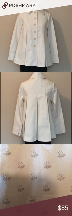 Ted Baker Swing All-Weather Coat This white Ted Baker London coat is stunning! It features gorgeous pleats making it look like a swing coat. The lining of tiny flowers is, like the coat, 100% cotton. It has pockets on the side and a Ted Baker chain for hanging on your coat rack! This coat will be a nice addition to any wardrobe! j Ted Baker London Jackets & Coats