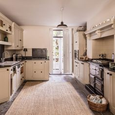 Traditional neutral kitchen with sisal rug