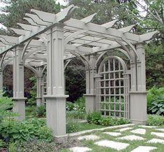 Hefty but intricate and decorative garden pergola/arbor/trellis structure as a backyard focal point.