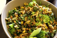 blanched broccoli with fresh herbs and pistachios.