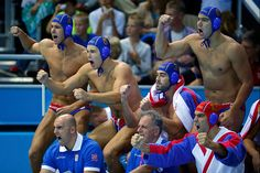 Serbia's players cheer for their team during their men's preliminary round Group B water polo match against Hungary at the Water Polo Arena during the London 2012 Olympic Games.