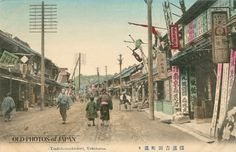 1910's. Yoshidamachi, Yokohama. People pass by shops on a quiet Yoshidamachi-dori. On the right is a drug store advertising goodies like Chujoto women's herbal supplement tea, bedbug extermination and industrial use chemicals. Sounds like a fun store to visit. Although quiet on this postcard, Yoshidamachi-dori was actually perfectly located and a popular street to go shopping.