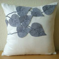 Felt leaves on cotton pillow. Leaves could be any color...like the simple design.