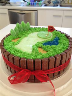 Golf cake bordered with kit kats! LOVE this!!