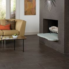 """St. Germain Sable 6"""" x 24"""" on the floor and Sable 1"""" x 2"""" mosaics on the fireplace wall."""