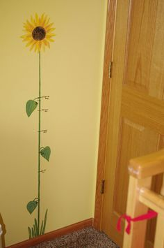 Love this idea for a growth chart. Thinking it would look great in a big green tractor themed nursery for a boy or maybe a sunflower themed nursery for a girl