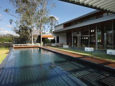 Eco Outdoor Abyss split stone paving used a pool coping and patio paving. Shaun Lockyer Architects | Eco Outdoor | livelifeoutdoors| Abyss split stone tiles | Outdoor design | Natural stone flooring | Garden design | Outdoor paving | Outdoor design inspiration | Outdoor style | Outdoor ideas | Paving ideas | Contemporary architecture | Contemporary pool ideas | Garden ideas | Outdoor tiles | Luxury homes