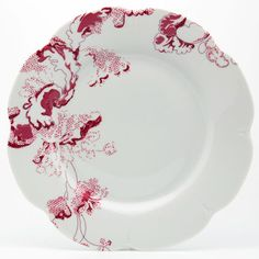 Tea Time dinnerware features a charming pink and red floral design in the spirit of Toile de Jouy.