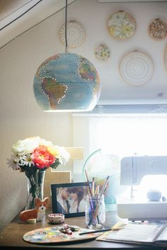 have a pretty big globe collection in my house and the one the started it  all had broken off its brackets last year and looked a bit sad.  I thought  it could use some new life so I turned it into a pendant lamp!  I get all  my globes from thrift stores and pretty much every time I see one I g