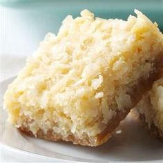 Buttery Coconut Bars Recipe -My coconut bars are an American version of a Filipino coconut cake called bibingka. These are a crispier, sweeter take on the Christmas tradition I grew up with. —Denise Nyland, Panama City, FL Coconut Desserts, Just Desserts, Delicious Desserts, Dessert Recipes, Yummy Food, Bar Recipes, Coconut Cookies, Coconut Macaroons, Recipies