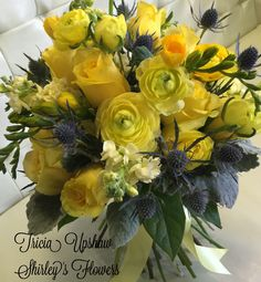 Love the yellow tara roses and ranunculus in this bridal bouquet.