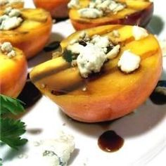 This is a deliciously simple end to a grilled meal. Peaches are grilled with a balsamic glaze, then served up with crumbled blue cheese. A sophisticated, extremely simple recipe that's perfect for summer entertaining!