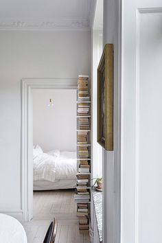 tall stack of books in white hallway / sfgirlbybay Hallway Decorating, Interior Decorating, Interior Design, Interior Architecture, Interior And Exterior, Casa Milano, White Hallway, Stack Of Books, My Dream Home
