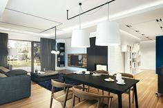 suspension de salle à manger, intérieur spacieux, lampes blanches pendantes et une grande table noire