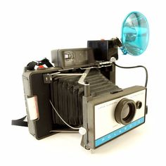 This retro Polaroid 210 Automatic Land Camera Outfit from 1968 is a blast to use to take modern day photos! This working camera looks like it was never used! Us