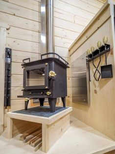 Wood Burning Stove - Crow by Blackbird Tiny Homes.  This type of wood stove for sure!