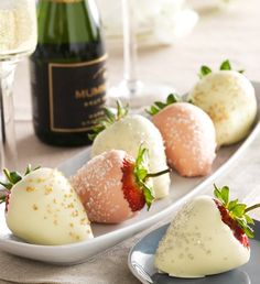 Fannie May Champagne Celebration Strawberries  It's the taste of luxury, of festive parties and elegant revelry, of divine strawberries paired with bubbly champagne!In this lavish collection, each giant, hand-picked strawberry comes generously dipped in creamy white and pink champagne-infused real chocolate and decoratively sprinkled with gold, platinum and clear sugar. Ready to celebrate?