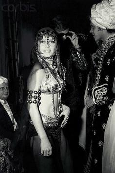 Original caption: Brigitte Bardot, French actress, wearing a belly dancer costume at the Baron Alexis de Rede ball, in Paris.