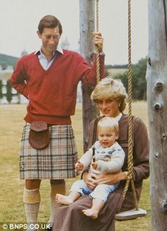 Prince William (William Arthur Philip Louis) (1982-living) of Wales, UK on his mother Diana's lap with his father Charles looking on, photographer unknown in 1983. William is the 1st Child of Diana Frances Spencer (1961-1997) Princess of Wales, UK & Charles (Charles Philip Arthur George) (1948-living) Prince of Wales, UK (m. 1981, div. 1996).