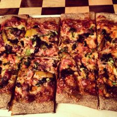 Homemade #pizza topped with prosciutto, mozzarella, caramelized onions, roasted sweet peppers, roasted broccoli, and franks