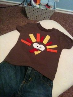 DIY Turkey Shirt! Super easy and could be done for any holiday. Plain shirt or onesie + felt pieces + hot glue = super cute fun!!