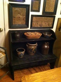 Past Time Primitives, love the crock stand and the samplers on the wall.