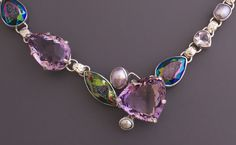 Sterling Silver Necklace with decorative links. Gemstones feature a large faceted Amethyst, electric blue-green Quartz Drusy and lavender hued Freshwater Pear.