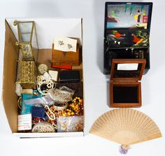 Lot 562: Costume Jewelry Assortment; Approximately eleven pounds of necklaces, pins, bracelets, earrings and jewelry boxes; together with a Florenza brooch and Seven Immortals bracelet