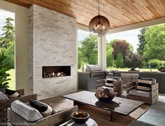 Outdoor fireplace with a stone veneer surround. #housetrends