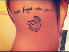 "Little ribs tattoo saying ""never forget who you are""."