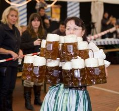 Amazing waitress carrying...A LOT of beer!