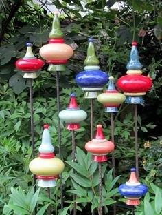 Maybe use different sizes of painted wooden finials