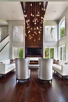 Cascading lights, love how the fireplace wall takes the color from the floor up....beautiful