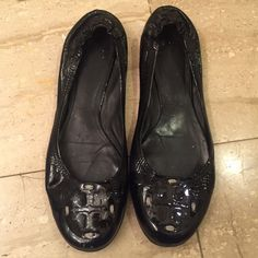 Tory Burch Black Patent Leather Reva Ballet Flats A Tory Burch favorite, the Reva Ballerina is sure to be your go-to shoe all year round! Patent leather upper, rubber sole, black patent leather logo.  Priced to reflect wear. Tory Burch Shoes Flats & Loafers