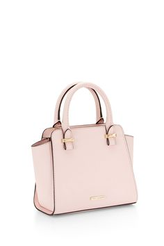 Loving the Micro Avery Tote from #RebeccaMinkoff . The older I get the more I like small and structured bags. I think this pink is a nice neutral pop of color for spring.