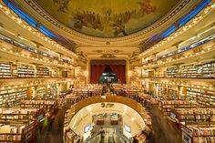 EL ATENEO GRAND SPLENDID, BUENOS AIRES, ARGENTINA Architect Fernando Manzone transformed a former theater into a spectacular branch of El Ateneo, the Argentine bookseller. Located in the Recoleta area, the 1919 building displays rows of books beneath the domed ceiling painted by Italian artist Nazareno Orlandi and along the ornate balconies. Avenida Sante Fe 1860, Buenos Aires; yenny-elateneo.com
