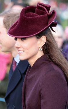 Kate Middleton wears aubergine coat and diamond earrings at the Royal Sandringham Christmas Service