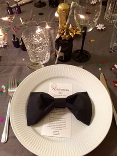 "This year we hosted a dinner with 11 good friends New Years Eve. Our 2015/2016 table decorations was with small ""champagne"" bottles as place cards, black butterfly napkins and of course confetti, stars, lights and glitter as it should be for New Years!"
