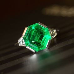 203cf4b2fcb50c Glowing green octagonal Art Deco style handmade emerald and diamond  cocktail ring. View our collection