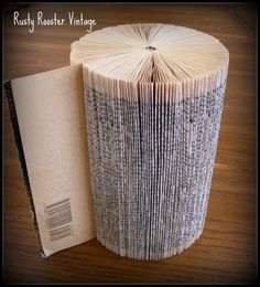 Fold paperback book pages to make cylindrical tower, for paper art