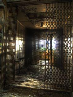 elevating prison by phoelixde.deviantart. com on @DeviantArt || old elevator cabin in an abandoned hospital complex in Beelitz Heilstätten, near Berlin