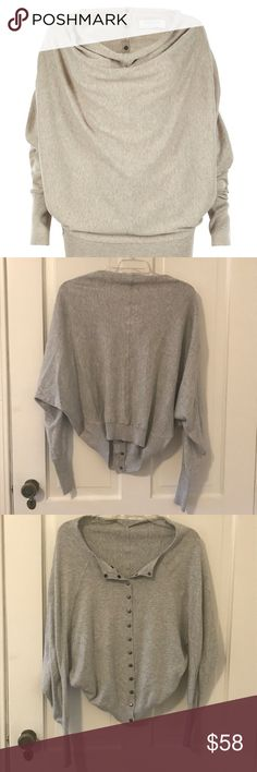 All Saints grey back buttoned blouse Cool blouse by all saints. The neck line is open and their are metal buttons on the back for a unique look. Great quality, no flaws. All Saints Tops Blouses